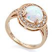 Золотое кольцо с опалом и фианитами SV-0506-328 весом 3.4 г  стоимостью 15300 р.